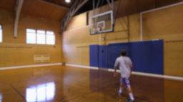 Boy playing indoor basketball alone (1 of 3) Footage
