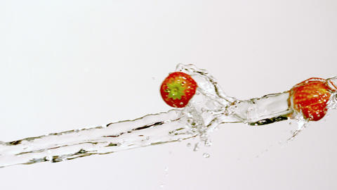 Strawberries moving through stream of water Footage