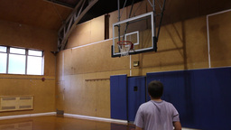 Boy playing indoor basketball alone (3 of 3) Footage