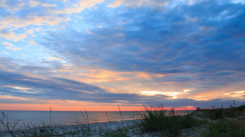 Dramatic Sky and Sunset over Beach. Time Lapse 4K Footage