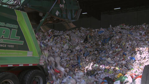 Dump trucks dumping waste (1 of 11) Footage