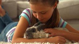 Happy girl with pet rabbit Footage