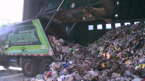 Dump trucks dumping waste (4 of 11) Footage