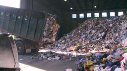 Dump trucks dumping waste (9 of 11) Footage