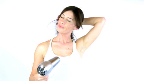 woman blow dry her hair smiling zoom in Stock Video Footage