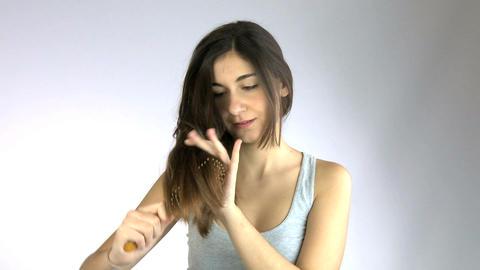 Girl brushing her hair Footage