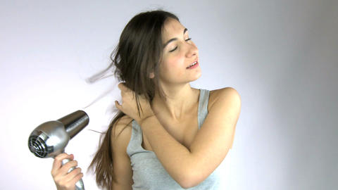 Girl hairdrying and smiling Stock Video Footage