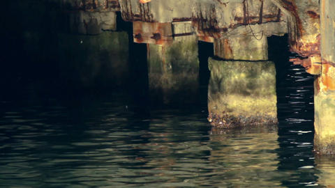 Sun glares under moorage Stock Video Footage