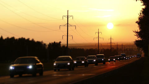 cars moving on road against sunset - timelapse Footage