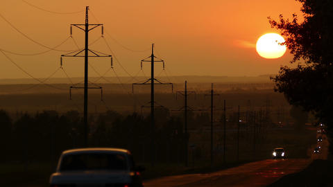 string of cars moving on road against sunset Footage