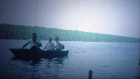 ARKANSAS, USA - 1964: Boat trip with kids showing off the latest fishing catch Footage