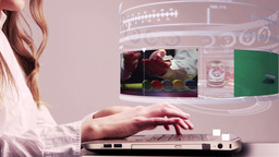 Woman using laptop with gambling holographic interface, Live Action