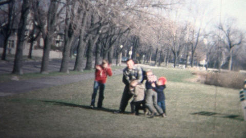 NEW HAVEN, CONNECTICUT - 1958: Family enjoying some football during the holidays Footage