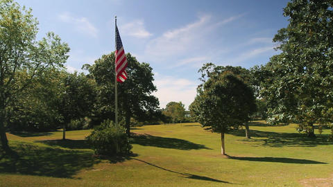 American Flag Flying in a field (1 of 3) Footage