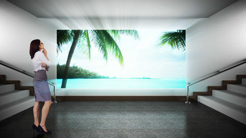 Businesswoman looking at screen showing beach paradise Animation