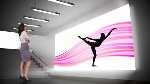 Businesswoman looking at ballerina silhouette Animation