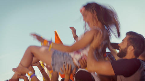 In high quality format happy hipster woman crowd surfing Footage