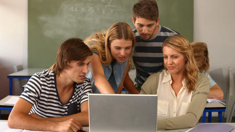 Group of students using laptop in classroom Footage