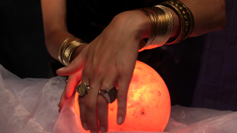 Fortune teller using crystal ball Footage