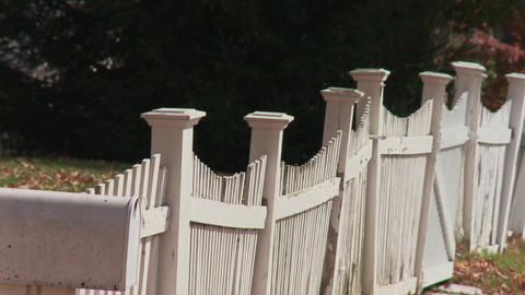 White picket fence along country road Footage