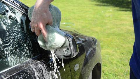 Close-up of man hand cleaning washing his car Footage