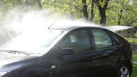 Closeup of car wash clean on sunlight with pressured water jet Footage