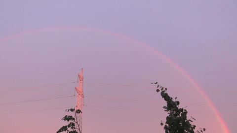 Sky with colorful rainbow under agriculture field. Panorama Footage
