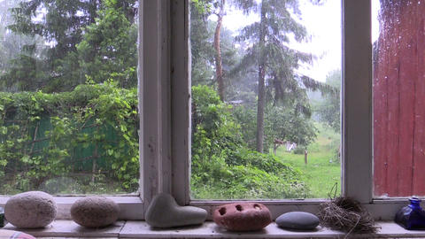 strong summery hail through the wooden window in rural house Footage