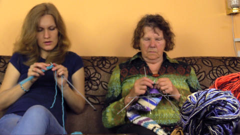old grandmother and young nurse knit and colorful balls of wool Footage