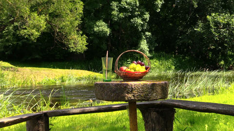 grape peach fruits and glass with champagne cider on millstone Footage
