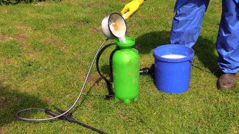 Farmer prepare pesticides chemicals for plant spray Footage