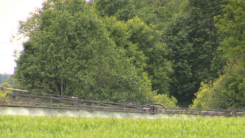 tractor sprayer sitting stream with fertilizer on crop field Footage