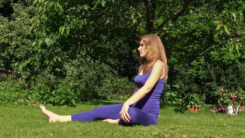 Pregnant woman yoga exercise during pregnancy outdoor at park Footage