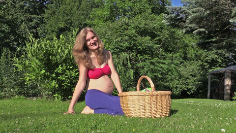 Little kitty cat jump out of wicker basket. Pregnant happy woman Footage