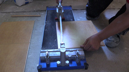 worker hand using tile cutter at home renovation work Live Action
