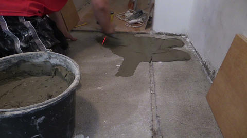 Handyman worker trowel spreading mortar for ceramic tile stick Footage