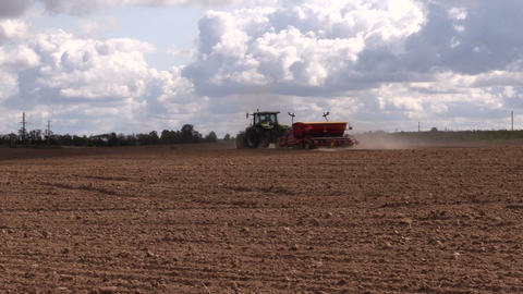Tractor fertilizer prepare soil in field. Planting crops Footage