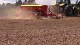 Special equipment spread fertilizer on field soil in autumn Footage