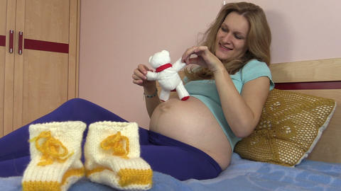 woolen shoes for baby and pregnant girl play with cat toy Footage