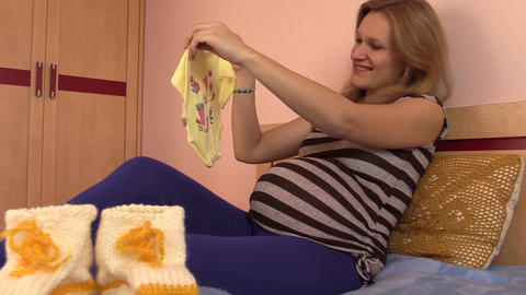 pregnant woman girl imagine her baby with creepers crawlers suit Footage