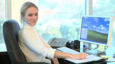 Professional Female Working at Her Desk (13 of 15) Footage