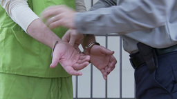 Guard Removes Inmates Handcuffs (1 of 9) Footage