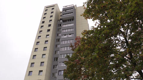renovated high flat apartment house and autumn tree Footage