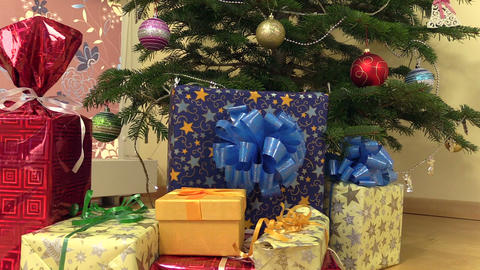 gift present boxes with ribbons under christmas fir tree Footage