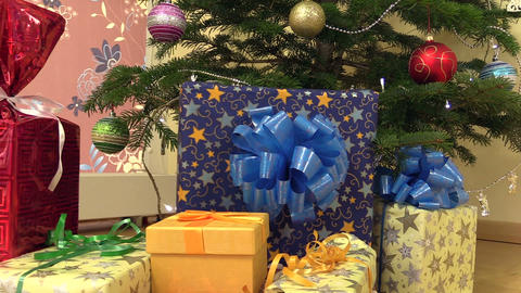 gifts presents boxes under christmas fir tree Footage