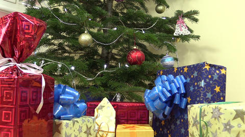 Heap of gifts presents boxes under decorated christmas fir tree Footage