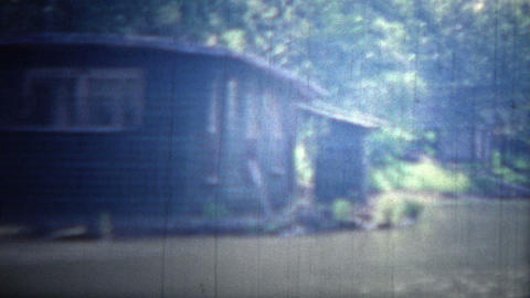 ARKANSAS, USA - 1965: Floating boathouses and living units on the flooded river Footage
