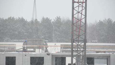 Heavy snow fall and construction site builders in winter Footage