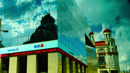 BUCHAREST, ROMANIA - June 2015,CEC Palace Mirrored In A Modern Building,Static S stock footage