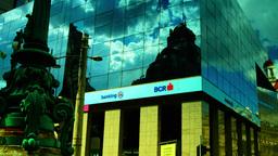 BUCHAREST, ROMANIA - June 2015,CEC Palace Mirrored In A Modern Building,Tilt stock footage